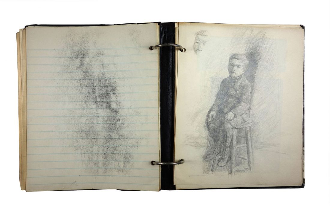 Binder with black chalk sketch of young boy sitting on stool; made in 1921/1922 by Charlotte Cummings while at the University of Wisconsin-Madison