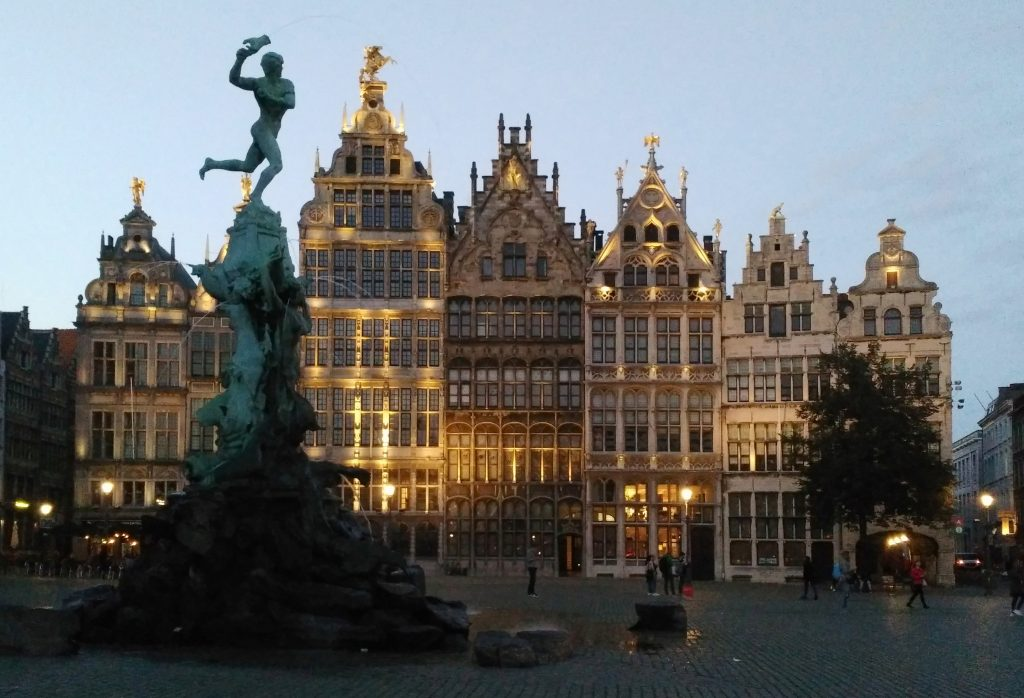 Market plaza, Antwerp with seven tall buildings at dusk