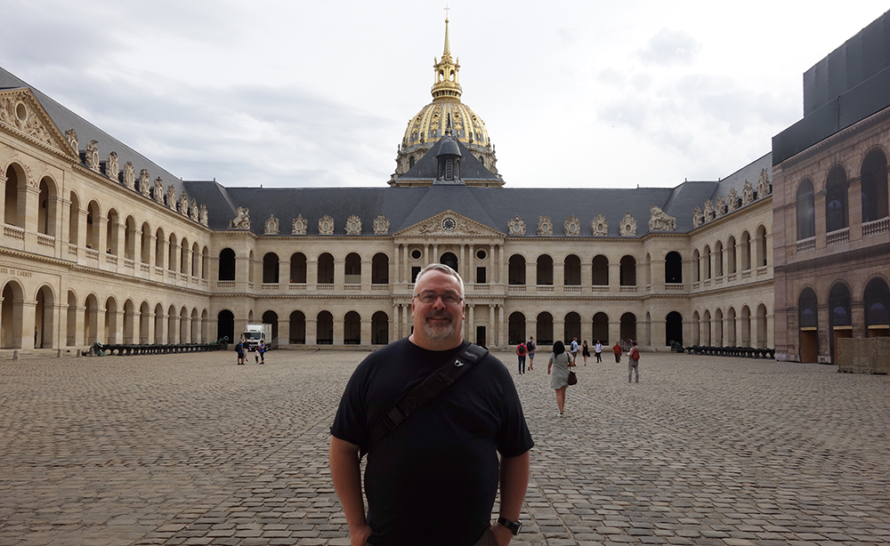 Aaron Gross standing inside the courtyard at Les Invalides, Paris