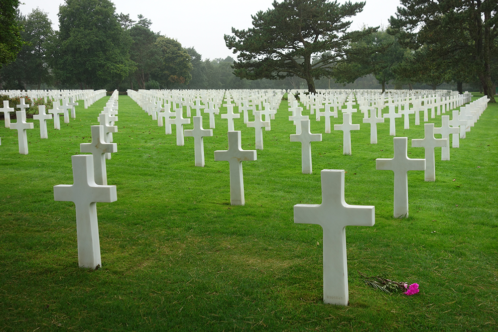 American Cemetery in Normandy, France with white crosses extending to the horizon