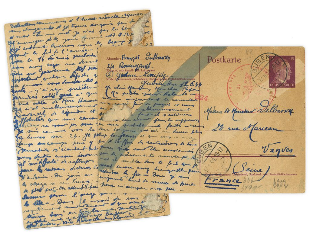 Front and back side of handwritten postcard from WWII covered with chemical censor marks