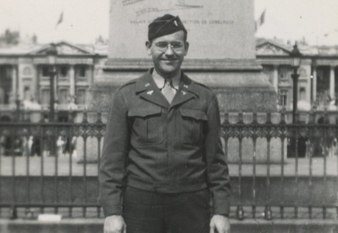 Photo taken on VE Day in Paris; shows smiling US intelligence officer Lewis J. Nescott