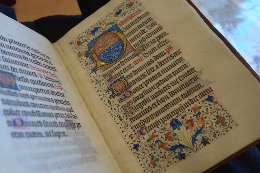 Close-up photo of illuminated manuscript; Letterform Archive, San Francisco
