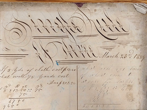 """Detail of ornate handwritten word """"Single Rule of Three"""" from 1859 math workbook of William D. Linebaugh"""