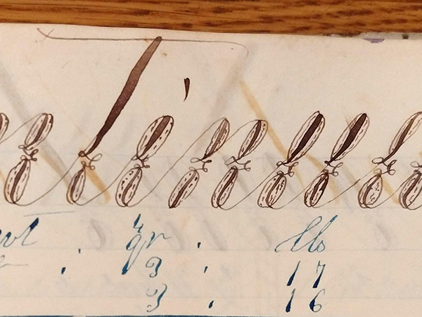 """Detail of ornate handwritten word """"Continued"""" from 1859 math workbook of William D. Linebaugh"""