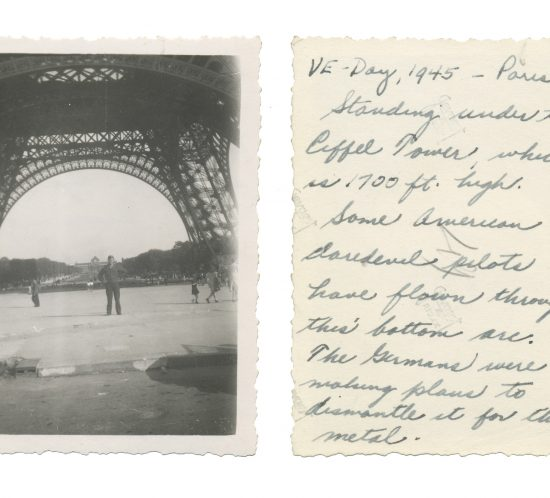 Photo taken on VE Day in Paris; shows US intelligence officer Lewis J. Nescott standing underneath the Eiffel Tower