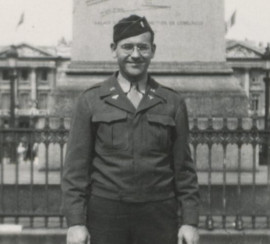 Photo taken on VE Day in Paris; shows smiling US intelligence officer Lewis J. Nescott
