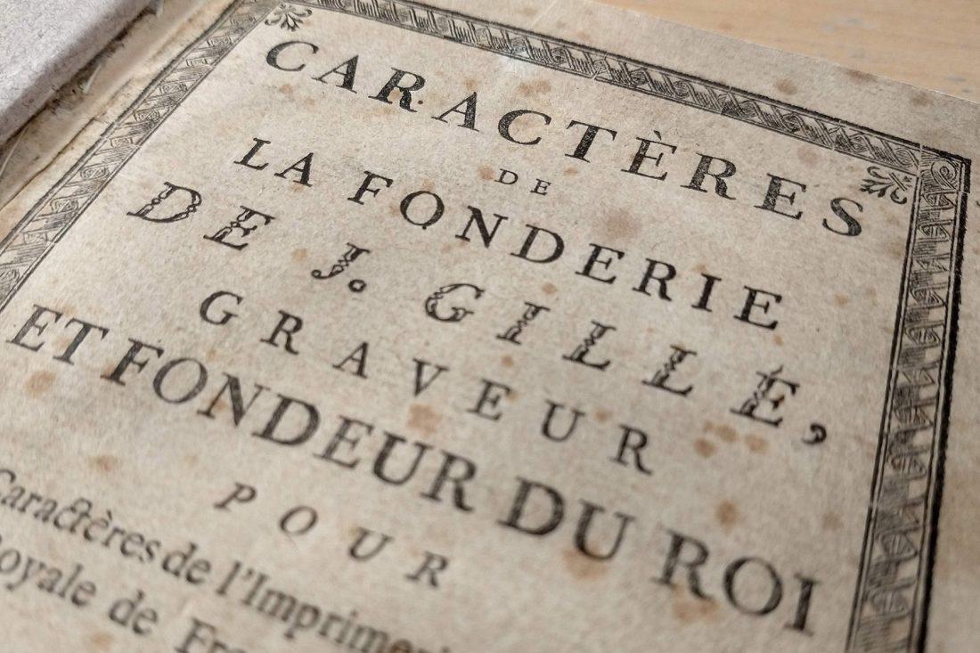 """Close up photo of type specimen book """"Caractères de La Fonderie de J. Gille""""; Letterform Archive, San Francisco"""