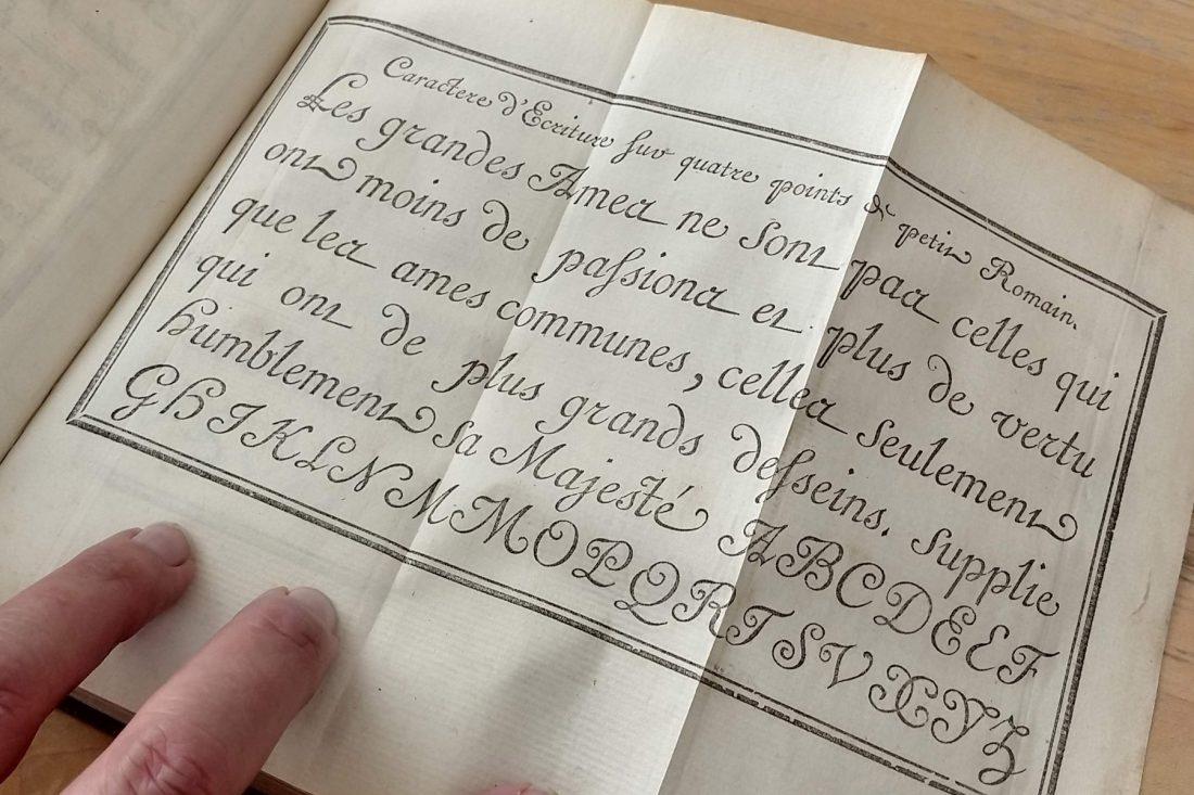 Close up photo of type specimen book; Letterform Archive, San Francisco