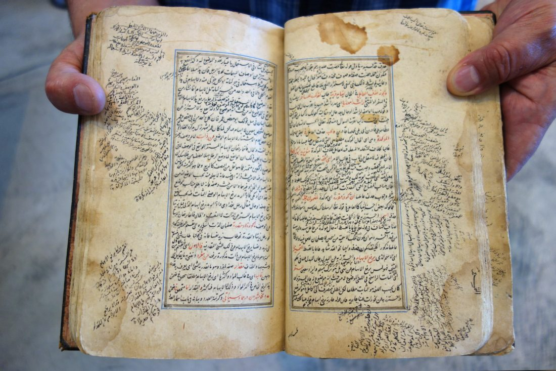 Close up photo of book hand lettered in Arabic; Letterform Archive, San Francisco