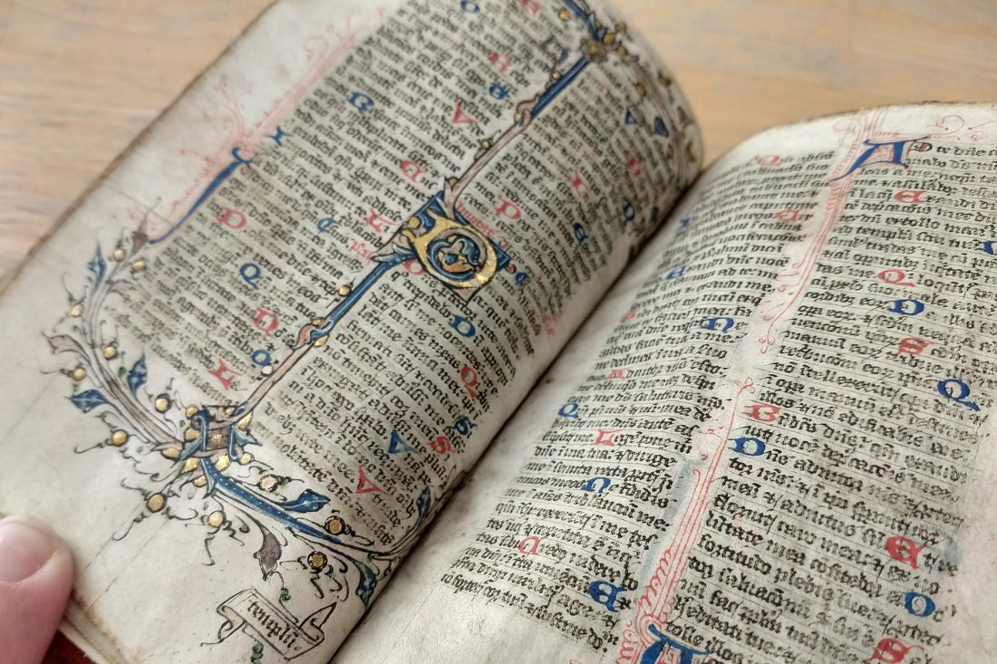 Close up photo of hand-lettered bible; Letterform Archive, San Francisco