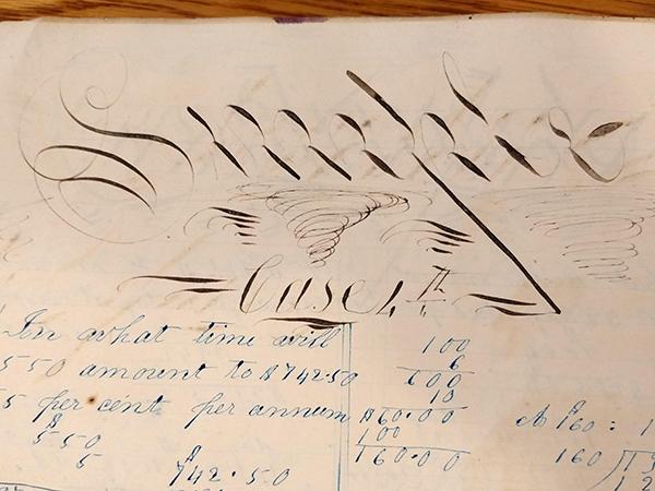 "Detail of ornate handwritten word ""Simple Case"" from 1859 math workbook of William D. Linebaugh"