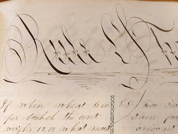 """Detail of ornate handwritten word """"Rule of Three"""" from 1859 math workbook of William D. Linebaugh"""