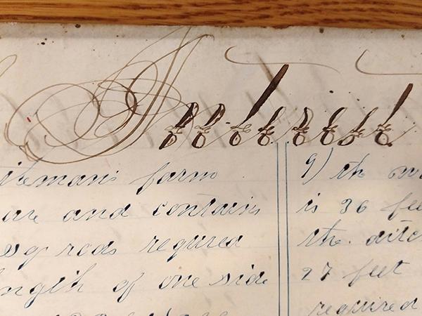 """Detail of ornate handwritten word """"Interest"""" from 1859 math workbook of William D. Linebaugh"""