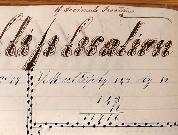 "Detail of ornate handwritten word ""Multiplication"" from 1859 math workbook of William D. Linebaugh"