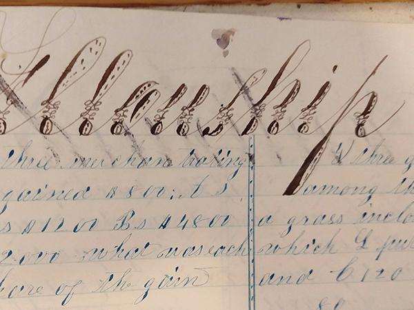 Detail of ornate handwritten word from 1859 math workbook of William D. Linebaugh