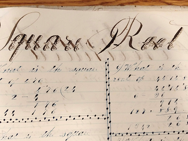 """Detail of ornate handwritten word """"Square Root"""" from 1859 math workbook of William D. Linebaugh"""
